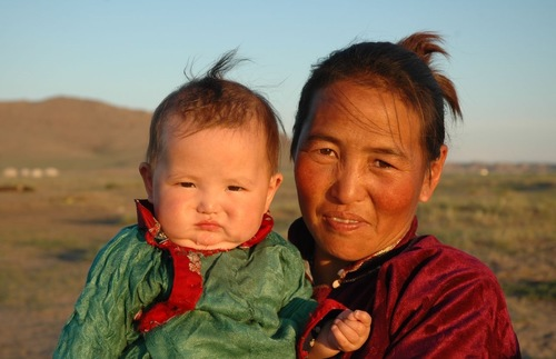 A Mongolian woman and her baby on the steppes of Mongolia