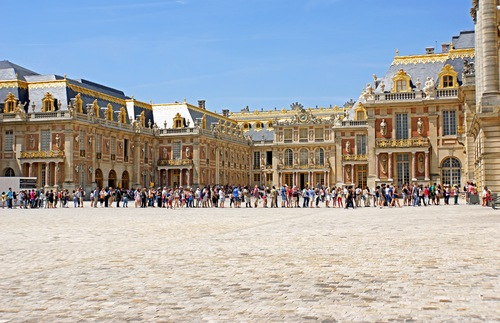 A massive line of people wait to get into Versailles in France.
