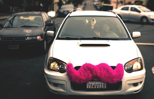A cheerful driver in a Lyft car.