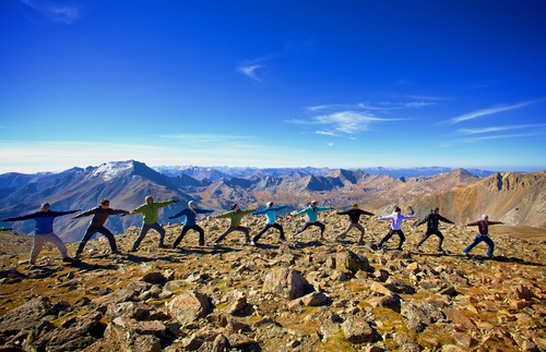 Yoga practitioners at the top of Mount Oxford, near Boulder, Colorado