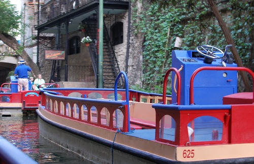 A tour boat waits for passengers to go cruising down the San Antonio River