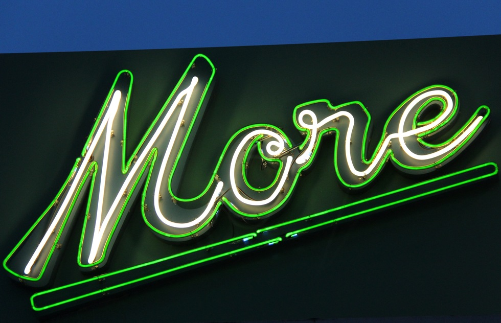 "A neon sign reading ""More"""