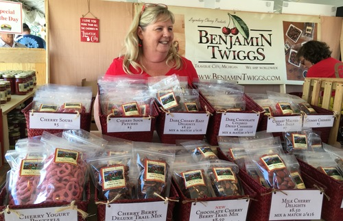 A woman sells cherry products of all sorts at the National Cherry Festival.