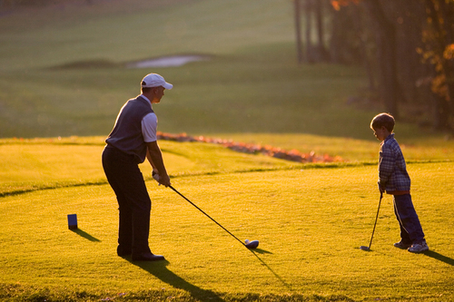 A father and son play golf at Wintergreen ski resort