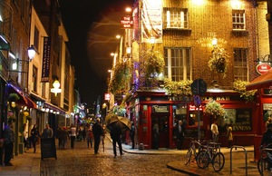 Lively nighttime street scene around Dublin's famous Temple Bar