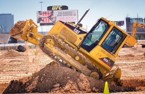 A student learns to drive a bulldozers at Dig This! in Las Vegas