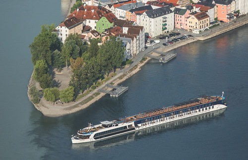 An AmaWaterways ship passes Passau, Germany