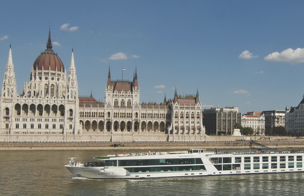 The Emerald Sun sails by Budapest