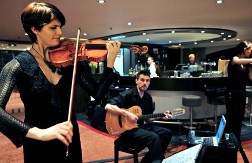 A violinist and guitarist perform aboard an Avalon Waterways river cruising ship