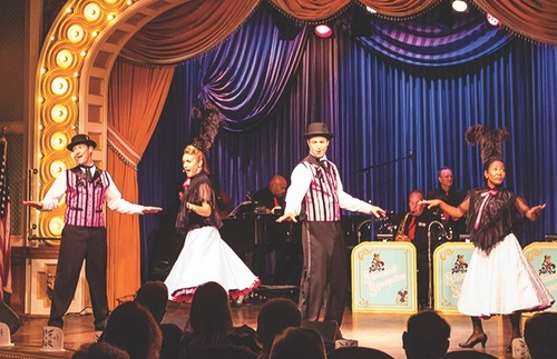 Performers ham it up during an old-timey music hall show aboard the American Queen Mississippi River cruise