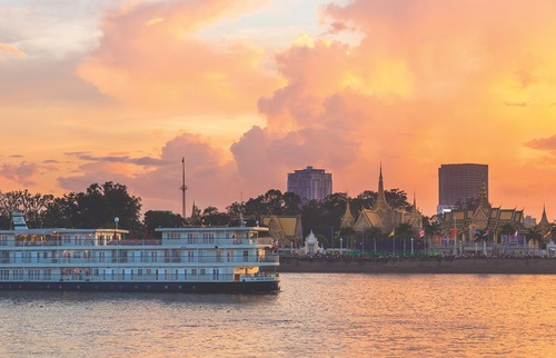 A river cruise ship navigates the Mekong River, which passes through Vietnam and Cambodia