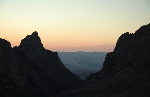 A sunset through the v-shaped Window rock formation at Big Bend National Park, Texas
