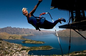 A bungee jumper takes the plunge over Queenstown, New Zealand