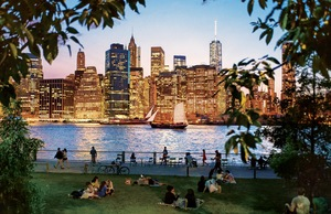 Glittering view of Lower Manhattan from Brooklyn Bridge Park in New York City