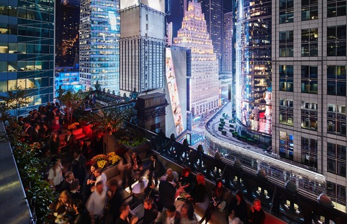 Revelers at St. Cloud, the rooftop bar at the Knickerbocker Hotel in Times Square