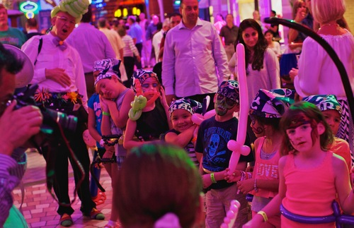 Children in an onboard parade on Oasis of the Seas.