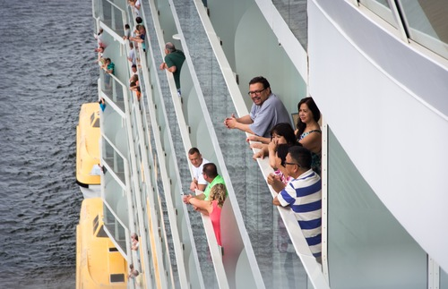 People peer out of their balconies aboard the Oasis of the Seas.