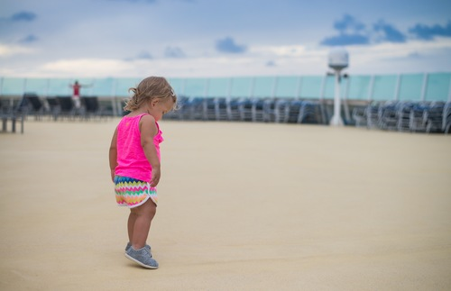 A baby on the deck of a Royal Caribbean ship