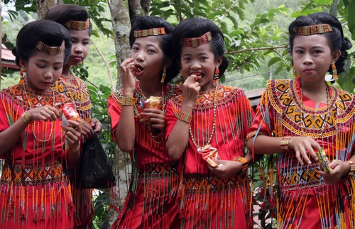 Young girls at a funeral in Sulawesi, Indonesia