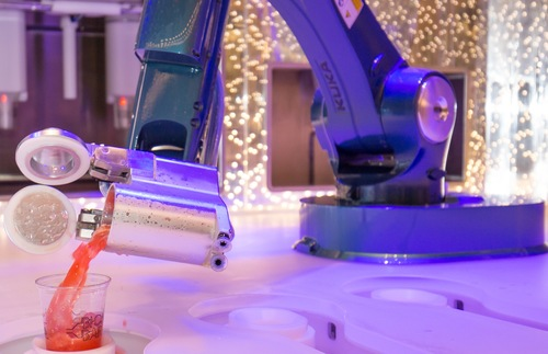 A robotic bartender pours a drink aboard Royal Caribbean's Harmony of the Seas