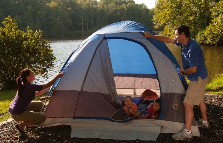 A family sets up a tent at a State Park in Virginia.