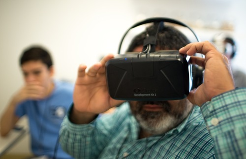 A man with a virtual reality headset.