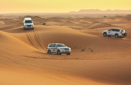 Jeeps on safari in Pink Rock Desert near Dubai