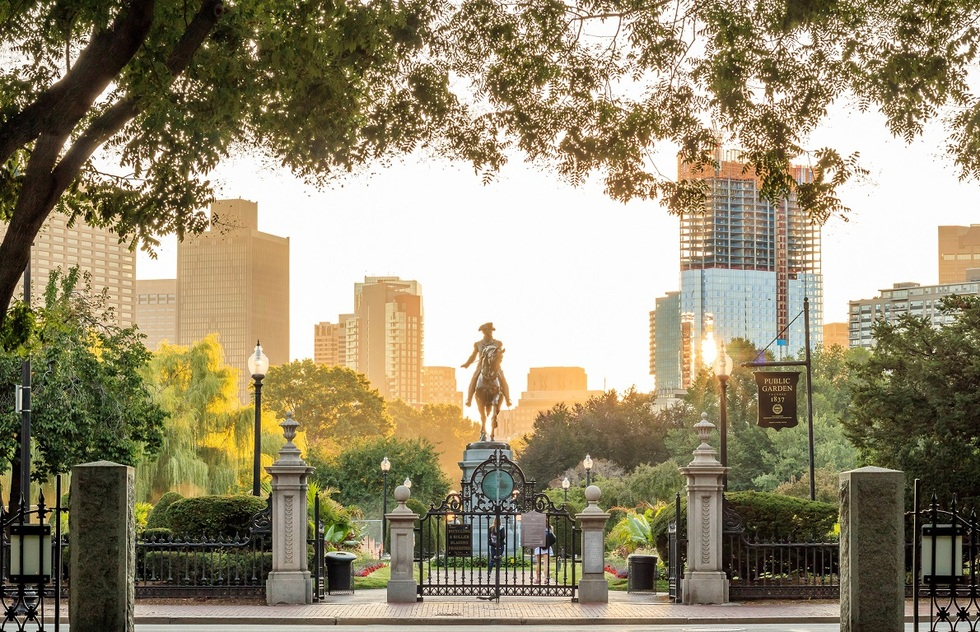 A statue of George Washington on horseback in the center of a public garden in Boston.