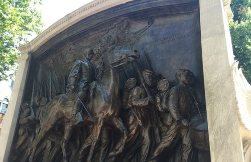 Bronze sculptor of the 54th Regiment marching, led by Colonel Robert Gould Shaw on horseback.