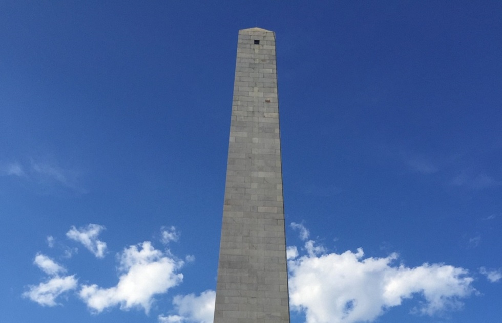 A 221-foot granite obelisk. Only the sky and a few clouds are visible around it.