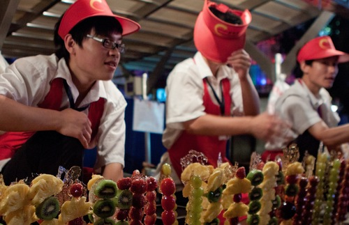 Fruit vendors at Wangfujing Snack Street in Beijing