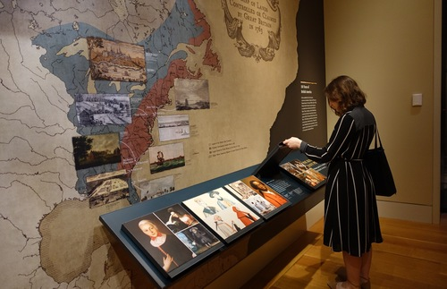A visitor looks at a display at the Museum of the American Revolution in Philadelphia
