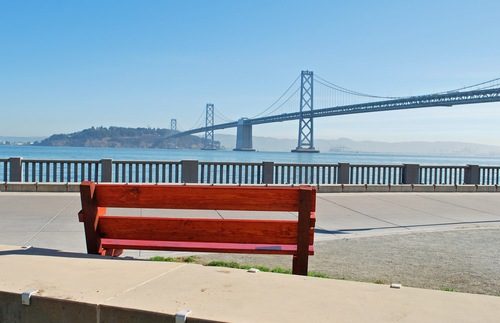 View of the Bay Bridge from the Embarcadero Promenade in San Francisco