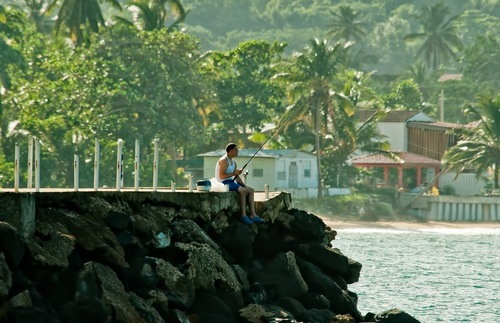 A fisherman at Luquillo Beach in Puerto Rico