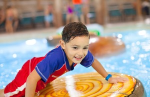 A kid at one of Great Wolf Lodge's indoor water park