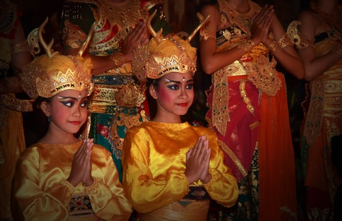 Two girls perform a dance version of the Ramayana in Bali, Indonesia