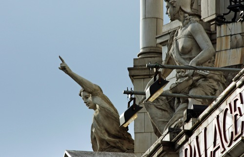 Statues on the Victoria Palace Theatre in London