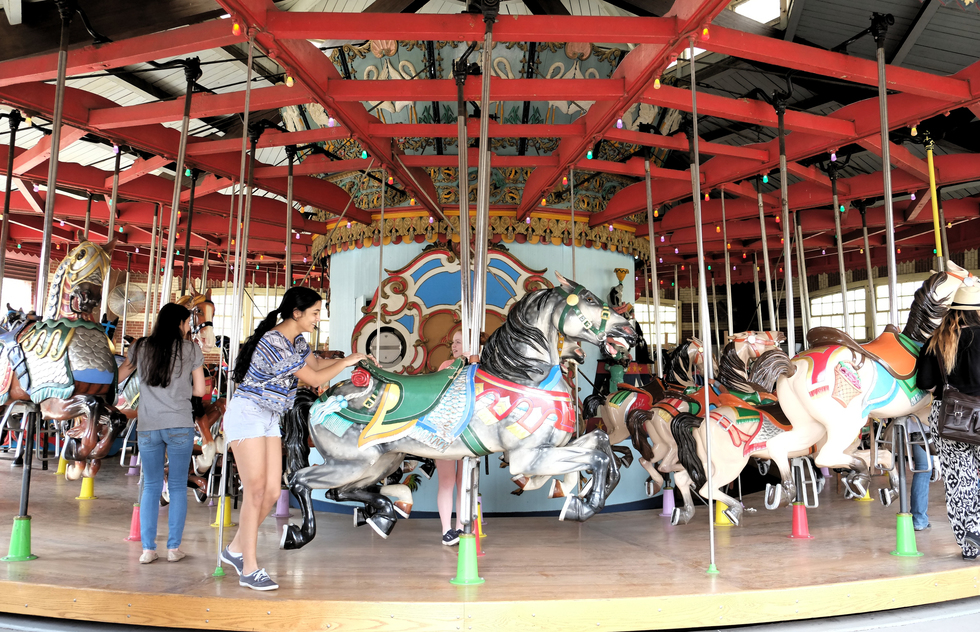 The friendly horses on the carousel are a perfect break from a day of sightseeing.