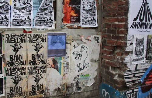 Fliers posted to a wall in Seattle's Capitol Hill neighborhood