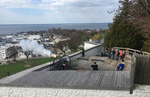 A cannon is fired from a tower of Fort Mackinac in Michigan