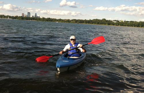 A kayaker takes on one of Minneapolis' 13 lakes