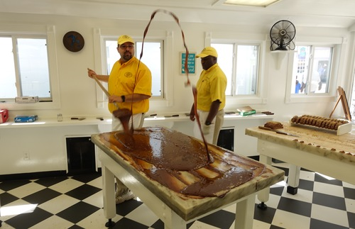 A candy maker at Murdicks makes fudge
