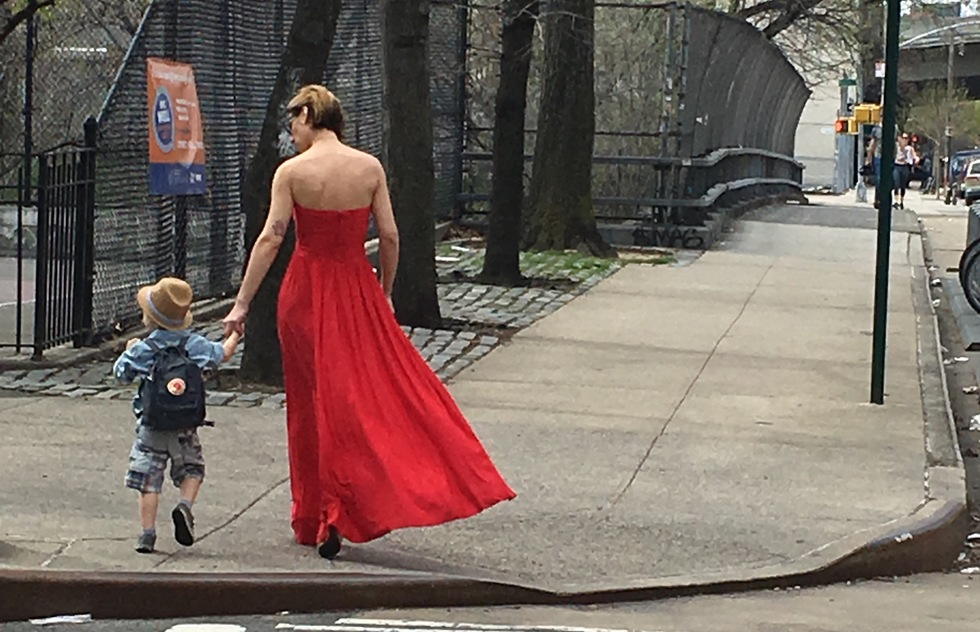 A mother and son walk through Williamsburg, Brooklyn