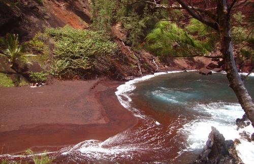 There is nothing else like the vibrant red beaches of Kaihalulu.