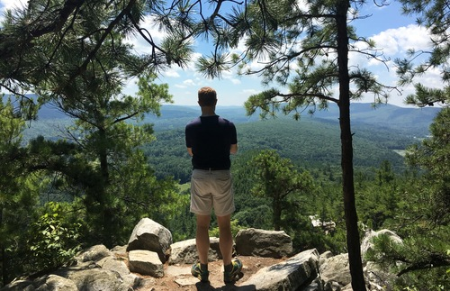A hiker takes in the views at Monument Mountain, the Berkshires