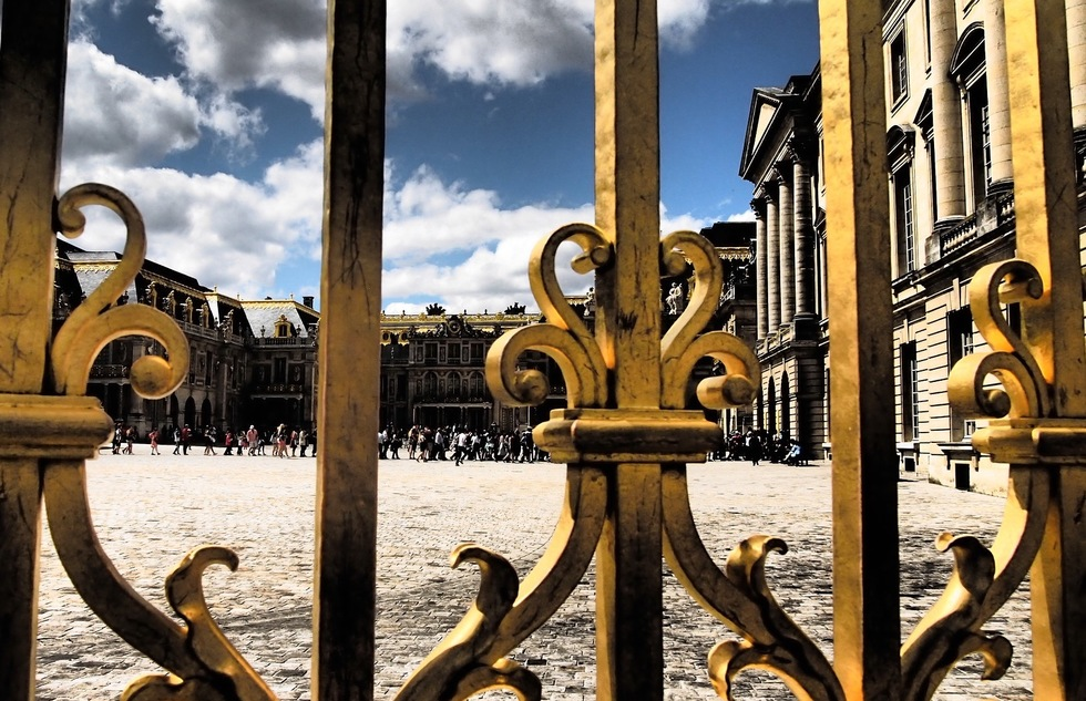 A long line of people wait to get into the Palace of Versailles in France