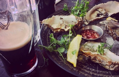 Guinness and oysters at the Guinness Storehouse in Dublin