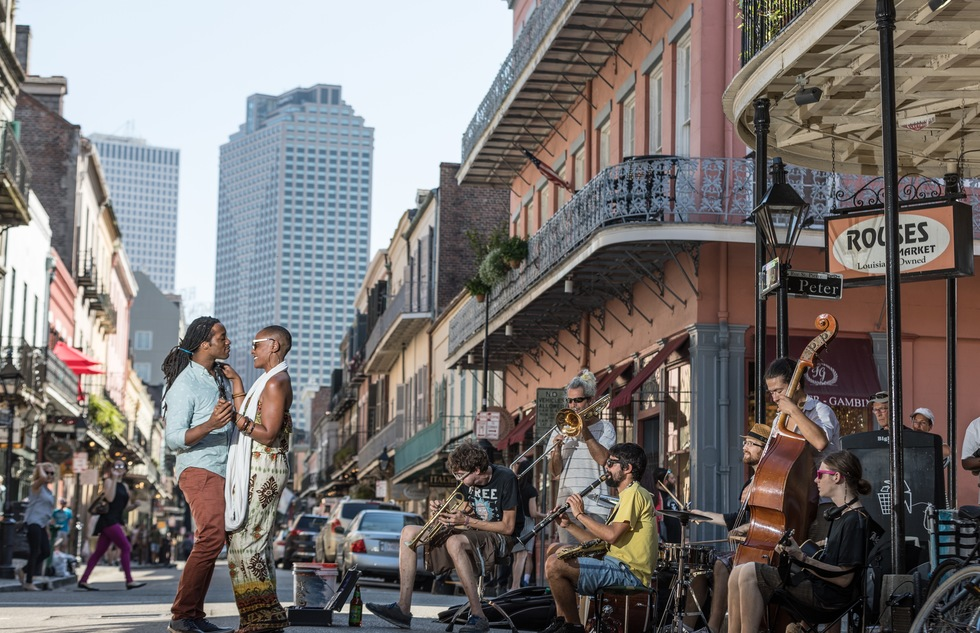 A couple dance to a band on the streets of New Orleans