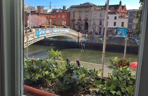 View of the River Liffey and Ha'penny Bridge from the Winding Stair in Dublin
