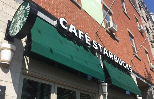 "A Starbucks in Montreal must add the word ""Cafe"" to its name to comply with French Canadian law."